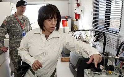 In this Jan. 21, 2010, file photo, Debra Michaels, Chemical Operations Manager demonstrates a gas chromatograph inside a mobile testing lab at the Army's Pueblo Chemical Storage facility in Pueblo, Colo. (AP Photo/Ed Andrieski, File)