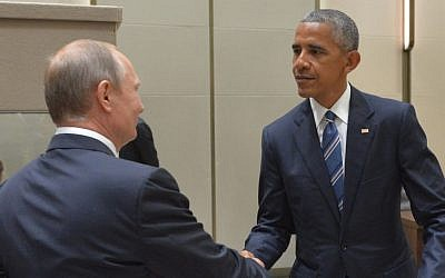 Russian President Vladimir Putin and US President Barack Obama shake hands at the G20 summit being held in Hangzhou in eastern China's Zhejiang province, September 5, 2016. (Alexei Druzhinin, Sputnik, Kremlin Pool Photo via AP)