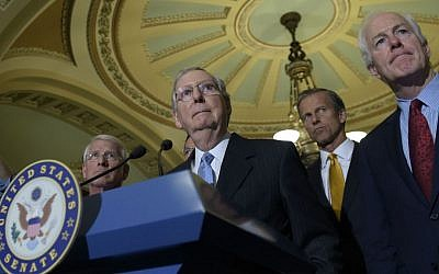 In this Sept. 13, 2016 file photo, Senate Majority Leader Mitch McConnell of Kentucky, second from left, standing with, from left, Sen. Roger Wicker, R-Mississippi, Sen. John Thune, R-South Dakota, and Senate Majority Whip John Cornyn, of Texas, at a press conference on Capitol Hill in Washington. (AP Photo/Susan Walsh, File)