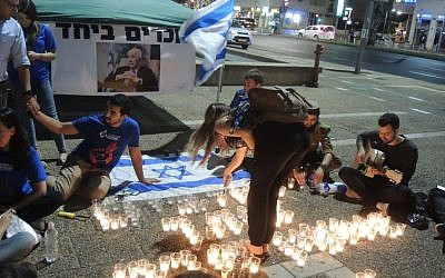 "Activists light candles that say ""We love you Shimon Peres"" at a memorial for the former president at Rabin Square in Tel Aviv on September 29, 2016. (Melanie Lidman/Times of Israel)"
