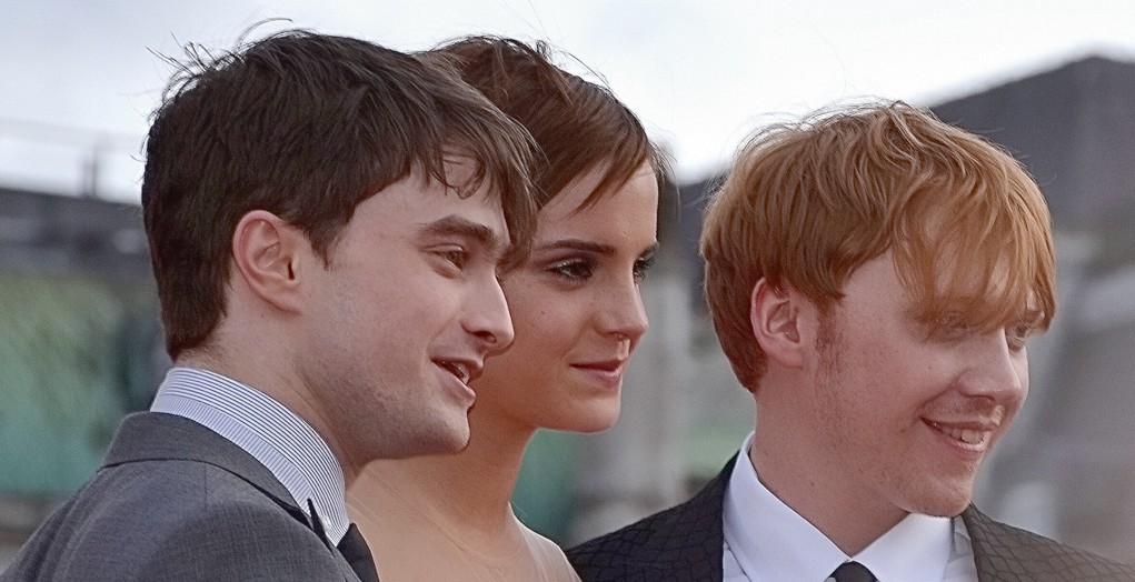 Daniel Radcliffe, Emma Watson and Rupert Grint (left to right) at the world premiere of Harry Potter & The Deathly Hallows Part 2 in London, July 2011 (Ilona Higgins - Flickr/ Wikipedia)
