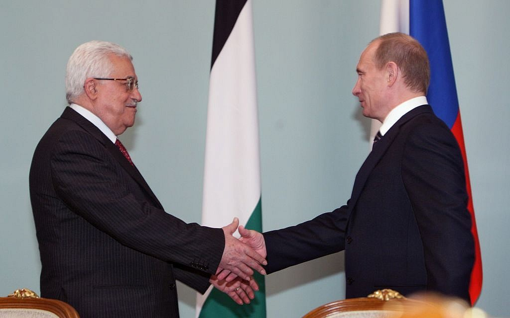 Mahmoud Abbas, left, and Vladimir Putin in Moscow on April 7, 2009. (Dmitry Azarov / Flash90)