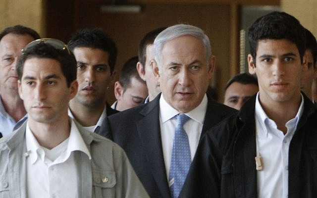 Illustrative: Prime Minister Benjamin Netanyahu flanked by security guards (Miriam Alster/Flash90)