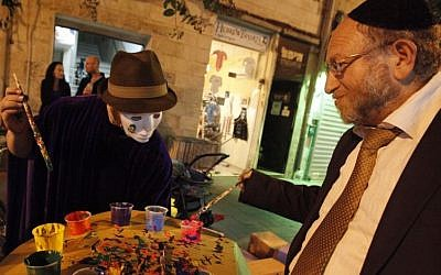 Illustrative. An ultra-Orthodox man gets in touch with his inner artist during the annual 'Manofim' art festival in Jerusalem. (Photo by Miriam Alster/Flash90)