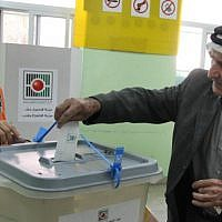 Illustrative: A Palestinian man casts his vote in the municipal elections in the West Bank town of Al-Bireh on October 20, 2012. (Issam Rimawi/Flash90)