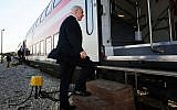 Benjamin Netanyahu boards a train from Tel Aviv to Beersheba on November 13, 2012. (Kobi Gideon/GPO/Flash90)