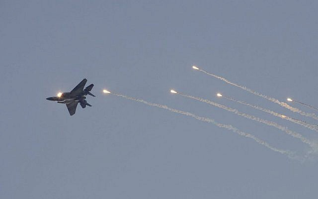 An F 15I Tactical Fighter Jet Releases Flares During A Graduation Ceremony Of New Israeli