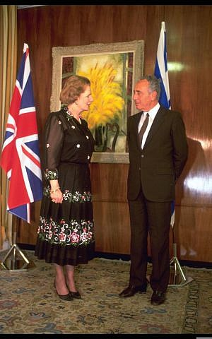 Israeli prime minister Shimon Peres seen with British prime minister Margaret Thatcher, during Thatcher's official visit in Jerusalem on May 26, 1986. (Sa'ar Yaacov/GPO/FLASH90)