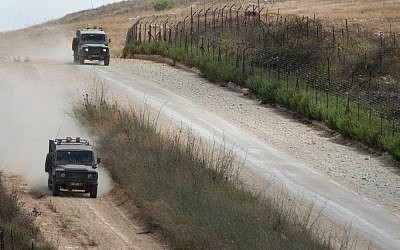 Israeli army jeeps patrol along the northern Israeli border with Lebanon on July 14, 2014 (Ayal Margolin/Flash90)