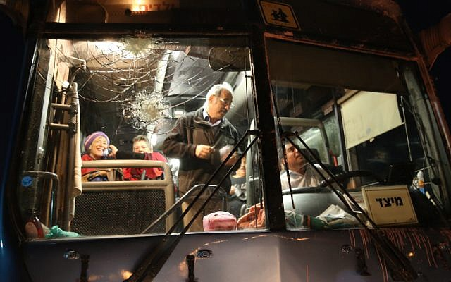 Illustrative. A bus was hit by rocks in the Etzion Bloc in the West Bank on September 10, 2014. (Gershon Elinson/Flash90/File)