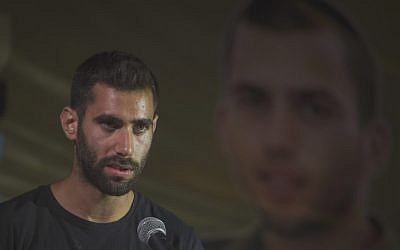 Aviram Shaul, the brother of fallen soldier Oron Shaul, speaks at a rally marking two years since his sibling's body was seized by Hamas, at a protest tent outside Prime Minister Benjamin Netanyahu's residence in Jerusalem,  July 20, 2016. (Hadas Parush/Flash90)