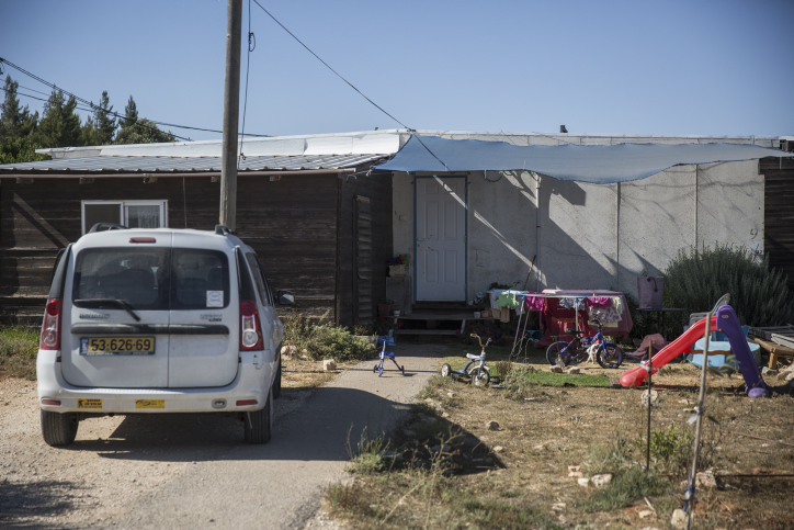 View of a street and caravan homes at the Amona Jewish outpost in the West Bank, on July 28, 2016. (Hadas Parush/FLASH90)