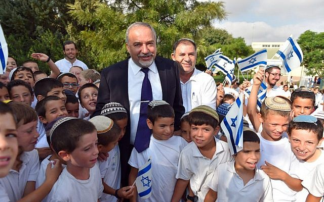 Defense Minister Avigdor Liberman visits Israeli students in the Israeli settlement of Susya, on their first day of school. September 1, 2016. (Ariel Hermoni/Ministry of Defense)