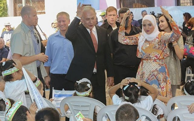 Prime Minister Benjamin Netanyahu welcomes new first grade students at the start of the school year in the Arab city of Tamra, on September 1, 2016. Photo by Flash90)
