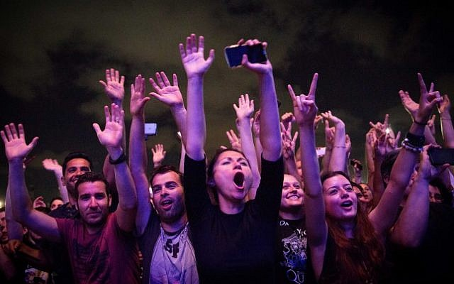 Fans cheer during a concert of American singer Adam Lambert and British band Queen in Hayarkon Park, Tel Aviv, September 12, 2016. (Miriam Alster/Flash90)