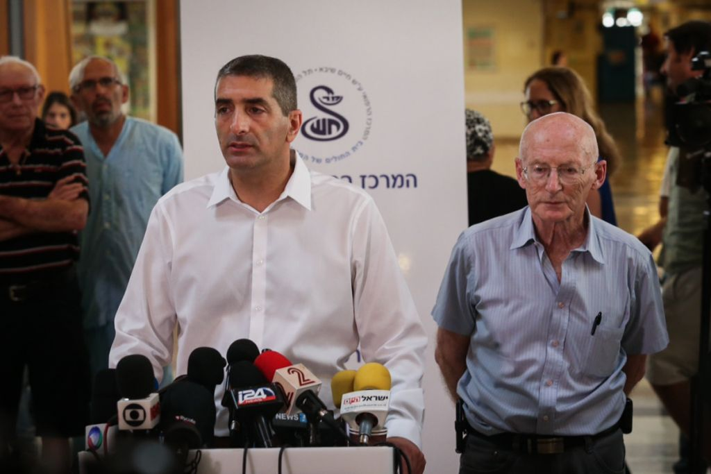 Head of the Sheba Medical Center, Itzhak Krais, and Professor Raphy Walden, son-in -law and personal physician of former Israeli president Shimon Peres, speak with media at the hospital on September 14, 2016. (Miriam Alster/Flash90)