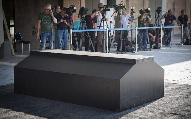 Press set up in front of a podium erected to hold the coffin of former Israeli President Shimon Peres at the Knesset, in Jerusalem, September 28, 2016. (Hadas Parushl/Flash90)