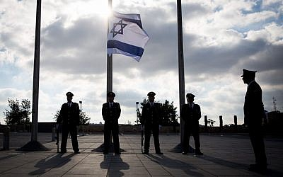 The Knesset honor guard lowers the Israeli flag to half-staff during a ceremony in memory of Shimon Peres on September 28, 2016 (Hadas Parushl/Flash90)