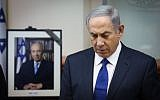 Prime Minister Benjamin Netanyahu in a moment of silence for Shimon Peres during a special cabinet session in Jerusalem, on September 28, 2016 (Marc Israel Sellem/POOL)