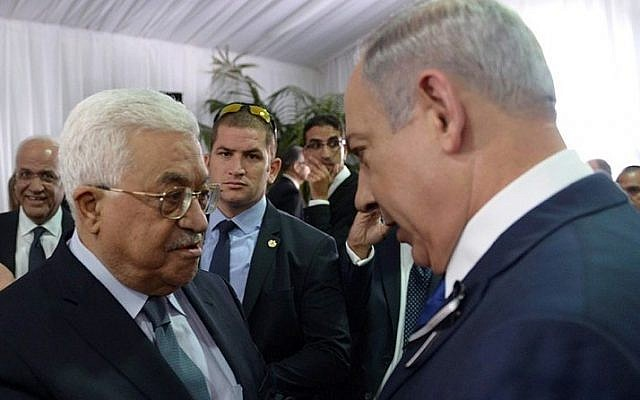Prime Minister Benjamin Netanyahu meets with Palestinian president Mahmoud Abbas during the state funeral of late president Shimon Peres, held at Mt. Herzl in Jerusalem on September 30, 2016. (Amos Ben Gershom/GPO)