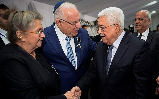 President Reuven Rivlin and his wife Nechama meet Palestinian Authority President Mahmoud Abbas during the State funeral for late former President Shimo Peres at Mount Herzl Cemetery in Jerusalem, on September 30, 2016. (Mark Neyman/GPO)