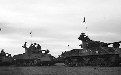 Israeli Sherman tanks advance toward the Mitla Pass during the 1956 Sinai Campaign. (Israel Defense Forces/Flickr)