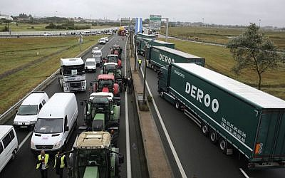 Truckers and farmers block the highway near Calais, northern France, Monday Sept. 5, 2016.  (AP/Thibault Camus)