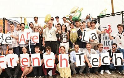 Participants of French hackathon at DLD Tel Aviv with entrepreneur Yossi Vardi, center. (Courtesy Aviv Hoffi).