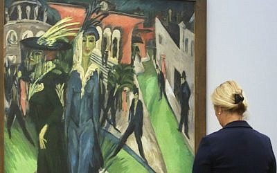 A woman stands in front of the painting 'Potsdamer Platz' from 1914 by artist Ernst Ludwig Kirchner displayed at the 'Hamburger Bahnhof - Museum for Contemporary Arts' in Berlin, Tuesday, Sept. 20, 2016. (AP Photo/Markus Schreiber)