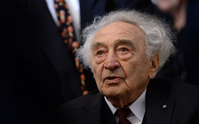 In this Jan. 27, 2015 file photo Holocaust survivor Max Mannheimer arrives for a ceremony marking the 70th anniversary of the Auschwitz concentration camp in Munich, southern Germany. (Andreas Gebert/dpa via AP, file)