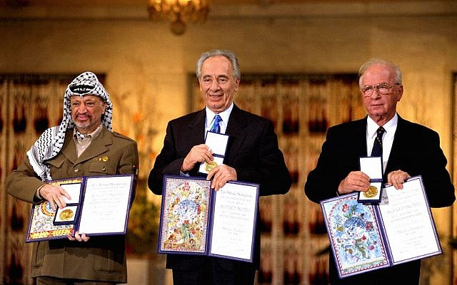 (R-L) Israeli Prime Minister Yitzhak Rabin, Israeli Foreign Minister Shimon Peres and Palestinian leader Yasser Arafat, the joint Nobel Peace Prize winners for 1994, in Olso, Norway. (Government Press Office via Getty Images)