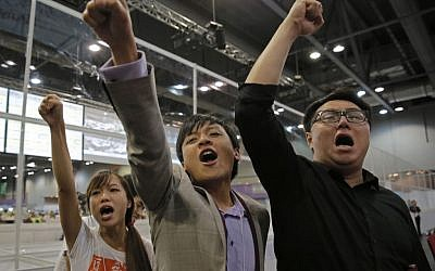 Candidates from Youngspiration group celebrate after Yau Wai-Ching (left) won a seat in the legislative council election in Hong Kong, Monday, September 5, 2016. (AP Photo/Vincent Yu)