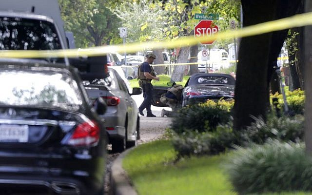 Police investigate the car believed to belong to the alleged shooter at the scene of a shooting along Wesleyan at Law Street in Houston that left multiple people injured and the alleged shooter dead, Monday morning, September 26, 2016, in Houston. (Mark Mulligan/Houston Chronicle via AP)