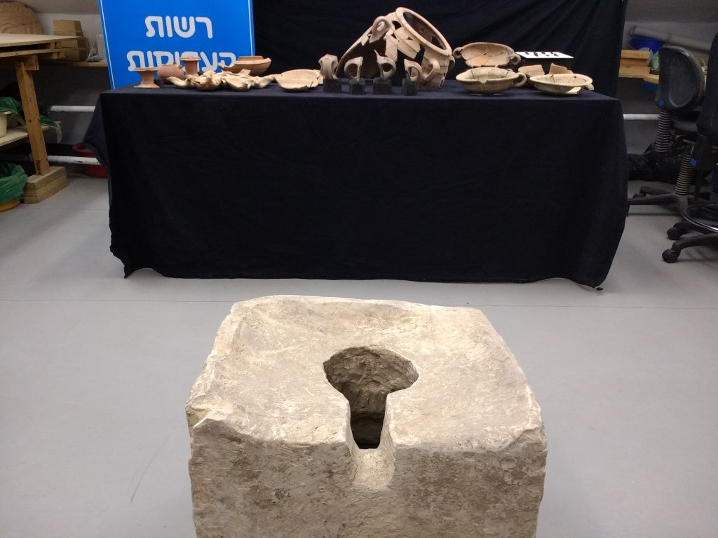 "An 8th century BCE ""symbolic"" toilet found at Lachish during the 2016 excavation by Israel Antiquities Authority archaeologists. (Ilan Ben Zion/Times of Israel staff)"
