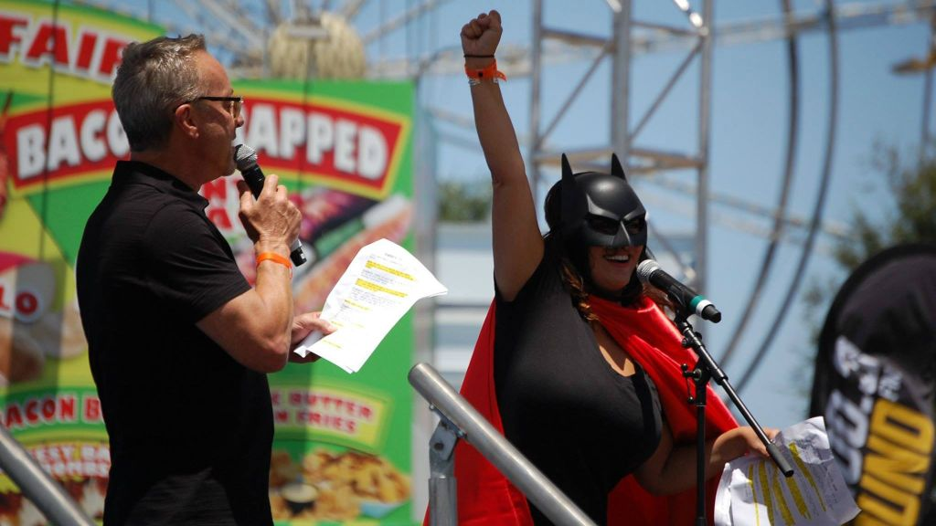 Mark Thompson and Gina Grad (clad in Batman costume), then of 'Mark in the Morning,' making a an appearance at the Orange County Fair. (Courtesy)