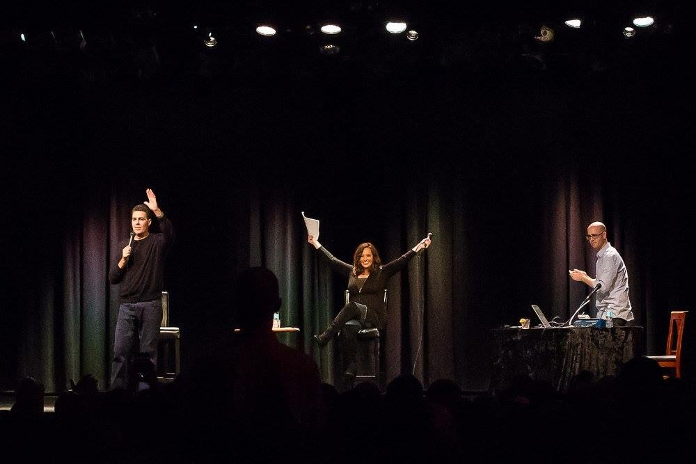 Gina Grad onstage performing the Adam Carolla Show live. (Courtesy)