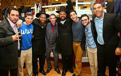 Students and their campus rabbis following a havdalah ceremony at the Chabad on Campus International Shabbaton in the Crown Heights section of Brooklyn, New York, November 8, 2014. (Chabad.edu/Bentzi Sasson via JTA)