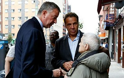 New York Mayor Bill de Blasio, left, and New York Gov. Andrew Cuomo talk with area residents Sunday, Sept. 18, 2016, while touring the site of an explosion that occurred on Saturday night in the Chelsea neighborhood of New York. (Justin Lane/EPA via AP, Pool)