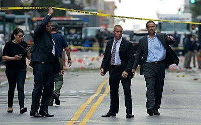 New York Gov. Andrew Cuomo, right, walks from the scene of an explosion in Manhattan's Chelsea neighborhood, in New York, Sunday, Sept. 18, 2016, after an incident that injured passers-by Saturday night. (AP Photo/Craig Ruttle)