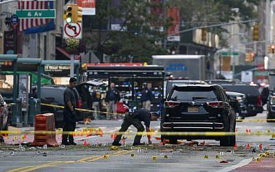 Crime scene investigators work at the scene of Saturday's explosion in Manhattan's Chelsea neighborhood, in New York, Sunday, Sept. 18, 2016. (AP Photo/Craig Ruttle)