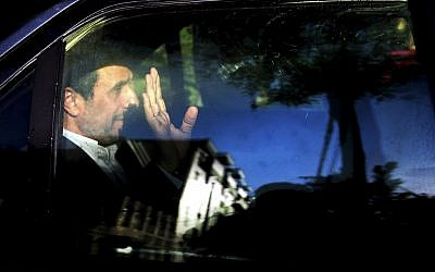 Former Iranian president Mahmoud Ahmadinejad waves from his car outside his house in northeastern Tehran, Iran, August 3 2016. (AP/Ebrahim Noroozi, File)