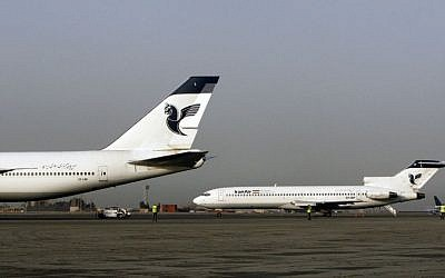 In this March 2, 2008 file photo, two passenger planes of Iran's national air carrier, Iran Air, are parked at the Mehrabad Airport in Tehran, Iran. (AP Photo/Vahid Salemi, File)