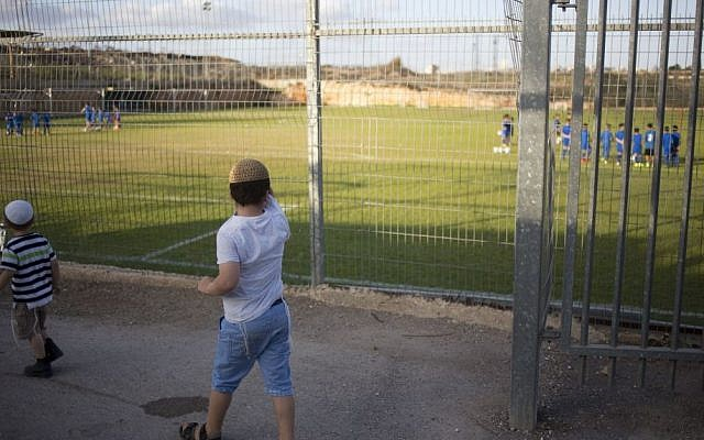 Children watch a soccer training session in the West Bank Jewish settlement of Givat Ze'ev, near Jerusalem, Sept. 22, 2016 (AP Photo/Ariel Schalit)