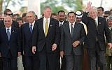 In this March 13, 1996 file photo, Russian President Boris Yeltsin waves as he and (from left to right) Jordan's King Hussein, Israeli Prime Minister Shimon Peres, US President Bill Clinton, Egyptian President Hosni Mubarak and, far right, PLO Leader Yasser Arafat make their way up to pose for the group photo at the end of their one-day Summit for Peacemakers in Sharm el Sheikh, Egypt. (AP Photo/Jerome Delay, File)