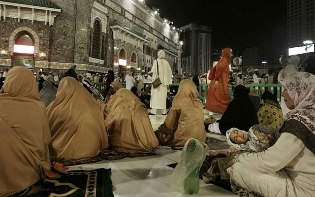 A Muslim woman from Kyrgyzstan, right, sleeps after the Fajr prayer before sunrise, outside the Grand Mosque in the Muslim holy city of Mecca, Saudi Arabia, Thursday, Sept. 8, 2016. (AP Photo/Nariman El-Mofty)