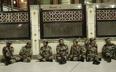 Saudi soldiers rest before praying the Fajr, prayer before sunrise, outside the Grand Mosque in the Muslim holy city of Mecca, Saudi Arabia, September 8, 2016. (AP Photo/Nariman El-Mofty)