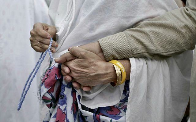 An elderly Indian woman leads her husband as they circle the Kaaba, Islam's holiest shrine, at the Grand Mosque in the Muslim holy city of Mecca, Saudi Arabia, Thursday, Sept. 8, 2016. (AP Photo/Nariman El-Mofty)