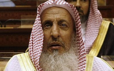 In this Tuesday, March 24, 2009 file photo, Sheikh Abdul Aziz al-Sheikh, the Saudi grand mufti listens to a speech of King Abdullah of Saudi Arabia at the Consultative Council in Riyadh, Saudi Arabia. (AP Photo/Hassan Ammar, File)