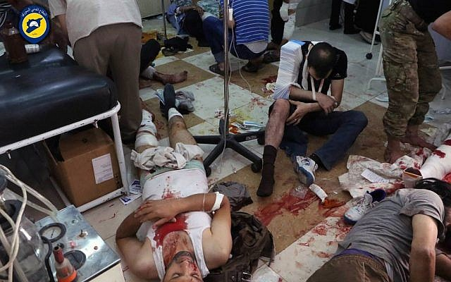 Wounded men receiving treatment at a local clinic after airstrikes hit in Aleppo, Syria, September 24, 2016. (Syrian Civil Defense White Helmets via AP)