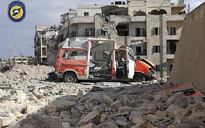 In this Friday, Sept. 23, 2016 photo provided by the Syrian Civil Defense group known as the White Helmets, a destroyed ambulance is seen outside the Syrian Civil Defense main center after airstrikes in Ansari neighborhood in the rebel-held part of eastern Aleppo, Syria. (Syrian Civil Defense White Helmets via AP)